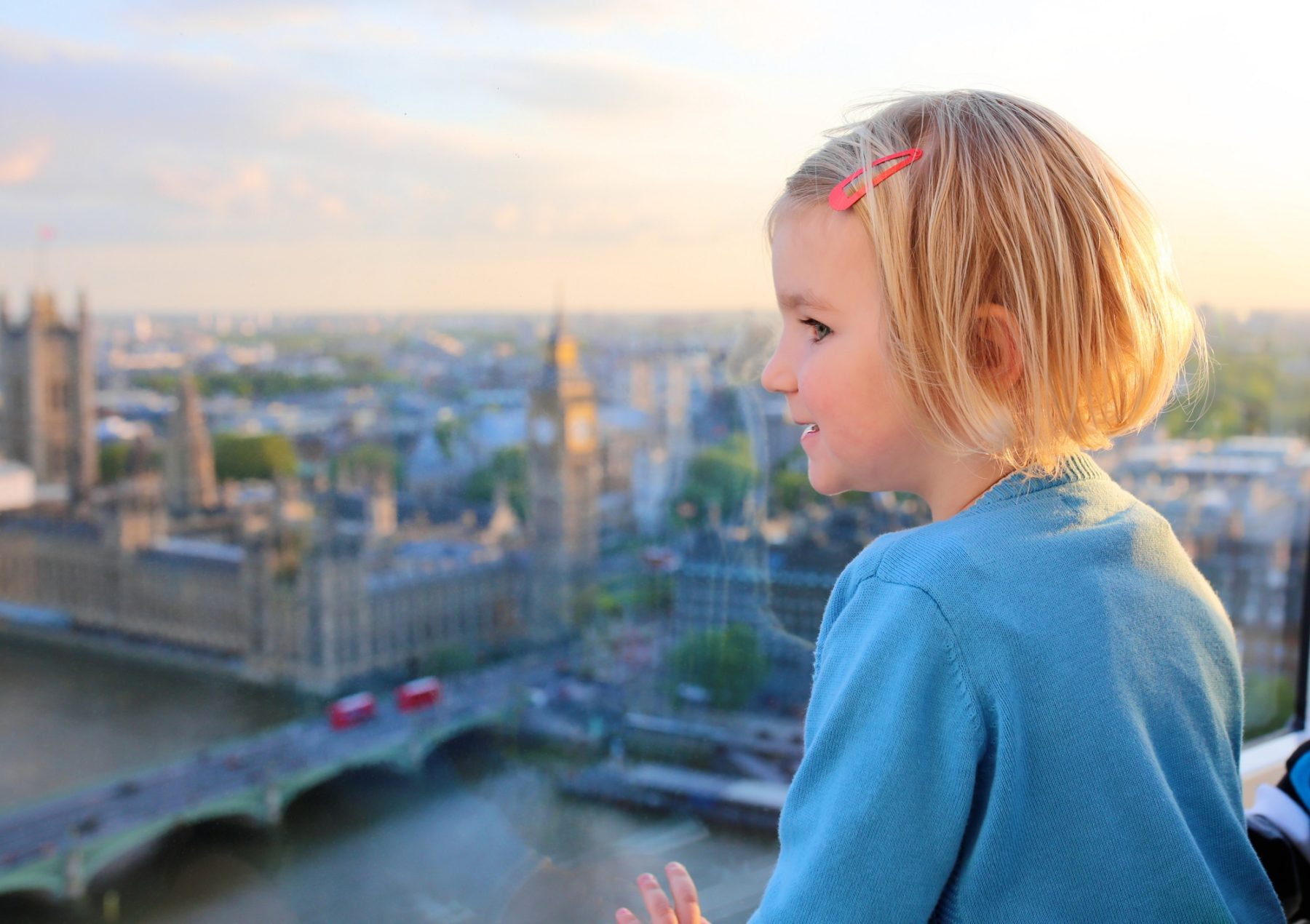 Child looking out from the London eye over London